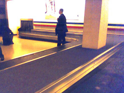 Guy Behind waiting for his luggage