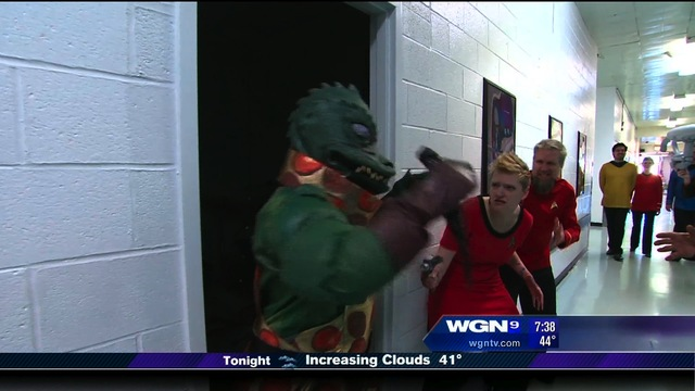 Fuzzy and Erica fighting a Gorn on the WGN Morning News